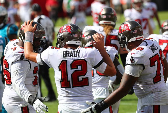 Tom Brady  showed he's back Sunday as he and his Tampa Bay Buccaneers teammates celebrate a touchdown on their way to defeating the Carolina Panthers at Raymond James Stadium.