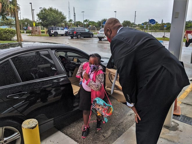 Palm Beach County Schools Superintendent Donald Fennoy greets students on the first day that schools were open for in-person learning. [SCHOOL DISTRICT OF PALM BEACH COUNTY]