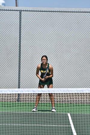 Senior Kassandra Heredia waits for the action to begin during the Greenbacks-hosted tennis tournament last Saturday in Pratt.