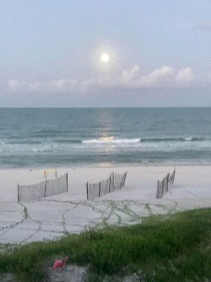The full moon setting over the Gulf of Mexico about 6 a.m. ET