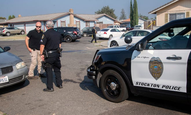 Stockton police officers and detectives investigate the scene of a homicide in the 400 block of Jill Court in Stockton on Monday morning. Police responded to a person shot at that location about 1:40 a.m. and found an unresponsive 37-year-old man with multiple gunshot wounds. The man was transported to a hospital where he was pronounced dead.