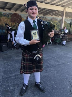Colin Speed sports the usual uniform he wears while playing bagpipes in solo competitions.