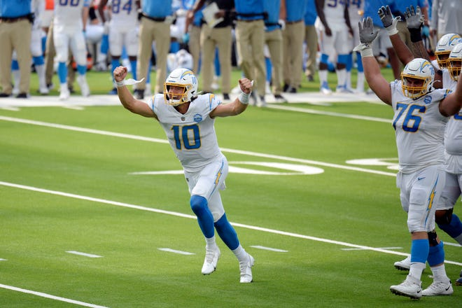 Los Angeles Chargers quarterback Justin Herbert celebrates after throwing his first career touchdown pass during the first half of an NFL football game against the Kansas City Chiefs on Sunday. (AP Photo/Kyusung Gong)