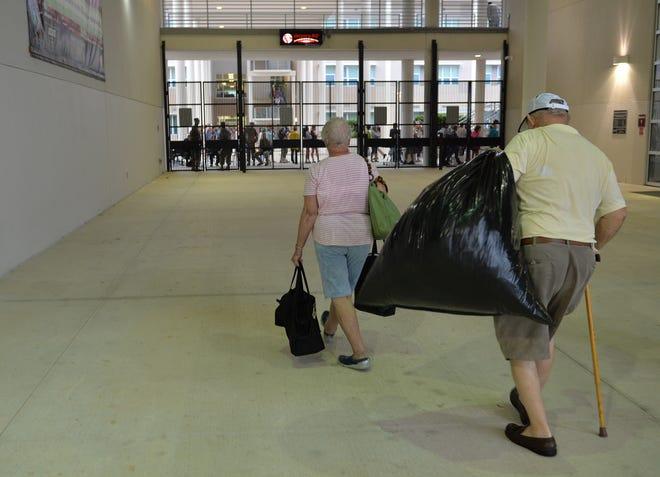 People evacuate to Riverview High School in Sarasota before Hurricane Irma in September 2017.