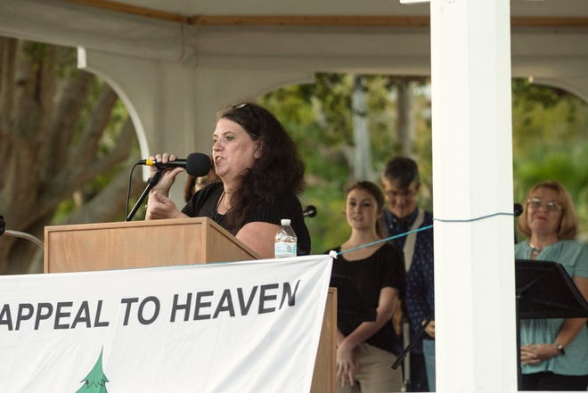 Sandy Black, one of the current organizers of the Venice Bible Read-a-Thon addresses the crowd at the 10th annual Venice Bible Read-a-Thon hosted in April 2019, at Centennial Park.