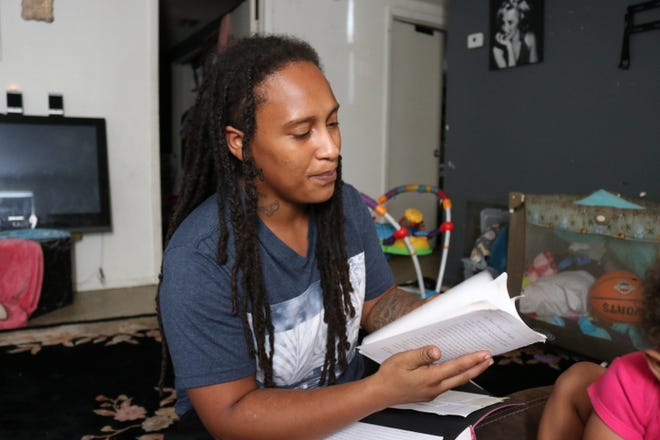 Shaterra Chism, 31, reads her poetry in her living room Friday afternoon, Sept. 18, 2020. The poetry she writes weekly helps her stay motivated and focused during the coronavirus pandemic, Chism said.