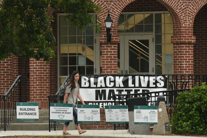 UNCW announced they will be removing all of their Black Lives Matter banners from around campus and moving them to an art exhibit.