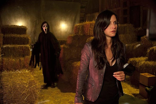 "Ghostface stalks Gale Weathers (Courteney Cox) in 2011's ""Scream 4."" The latest installment in the horror franchise begins filming in Wilmington this week. [PHOTO COURTESY OF DIMENSION FILMS]"