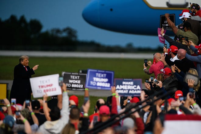 President Donald Trump arrives at a campaign rally at the Fayetteville Regional Airport on Saturday, Sept. 19, 2020.
