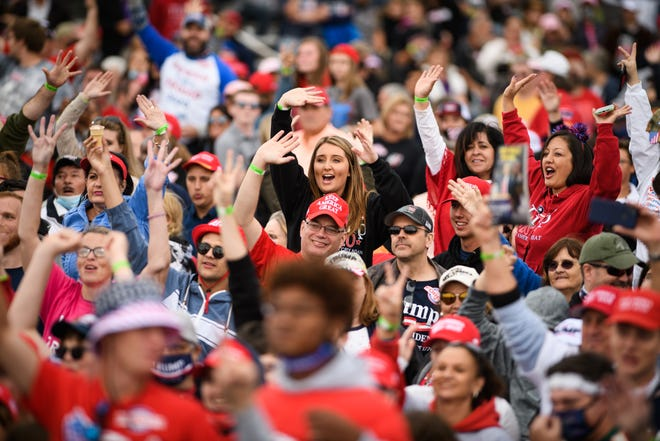 "Trump supporters yell ""four more years"" at President Donald Trump's campaign rally at the Fayetteville Regional Airport on Saturday."