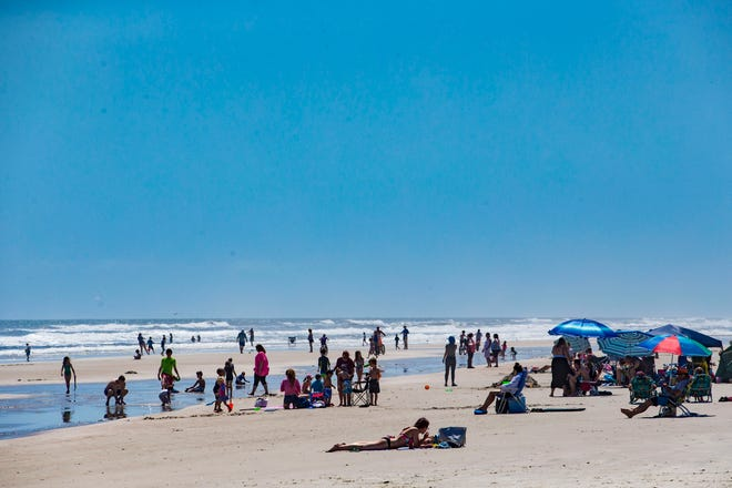 People enjoy the spring break weather at Crescent Beach, in March 2018.  [Lauren Bacho/Gainesville Sun]