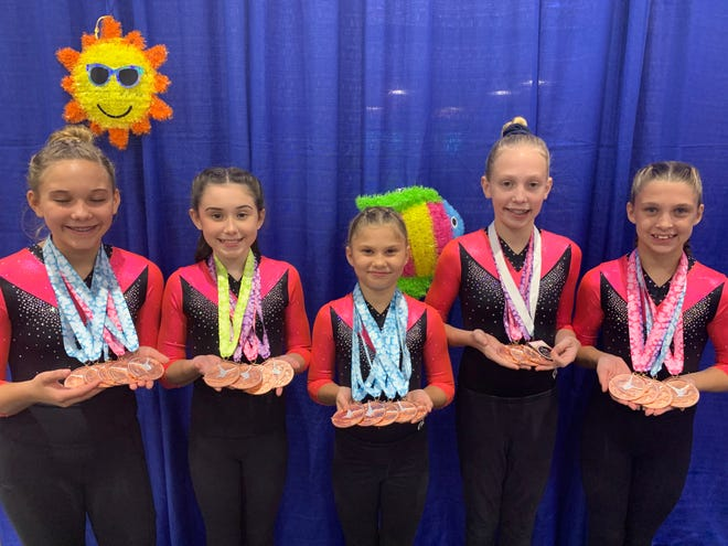 Edgewater Gymnastics team, from left: Mackenzie Glover, Lauren Timmins, Mikala Holmes, Madelyn Kimball, Chloe Breedon.