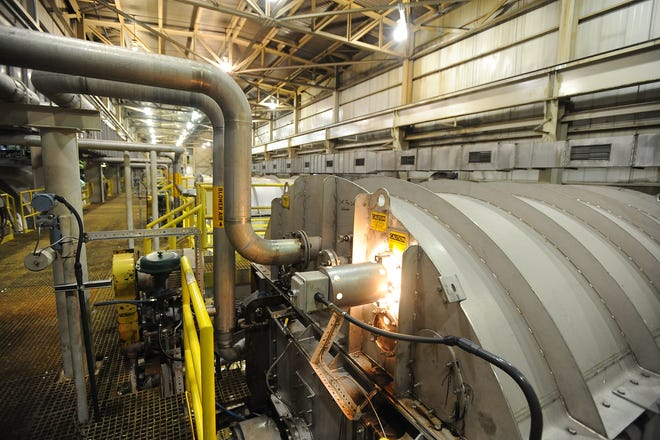 Wood pulp is processed in the pine fiber line building at Evergreen Packaging in Canton in this 2009 file photo. The mill produces paper for liquid packages and cups, as well as commercial paper. Two contract company employees died at a fire at the mill in September 2020.