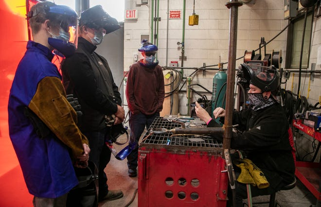 Masked up students listen to instruction from parttime lab tech. Tony Johnson, right, at Washtenaw Community College in Ann Arbor during classes in the Occupational Education building Tuesday, Sept. 15, 2020.