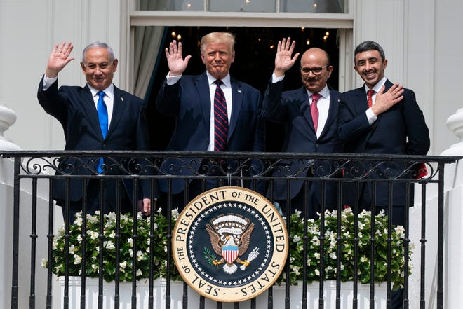 Israeli Prime Minister Benjamin Netanyahu, left, President Donald Trump, Bahrain Foreign Minister Khalid bin Ahmed Al Khalifa and United Arab Emirates Foreign Minister Abdullah bin Zayed al-Nahyan react Tuesday on the Blue Room Balcony after signing the Abraham Accords during a ceremony on the South Lawn of the White House in Washington.