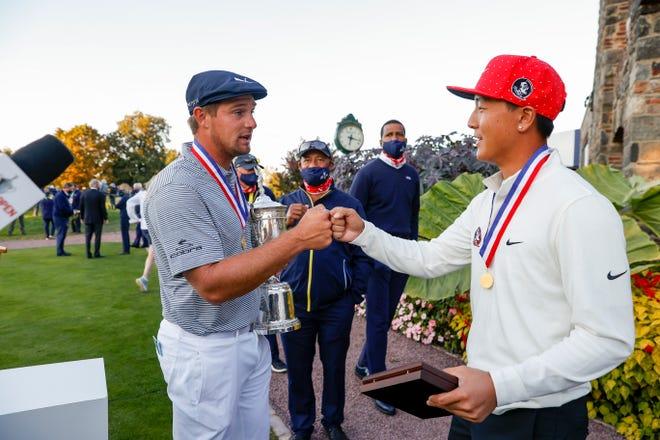 Bryson DeChambeau, left, greets the low amateur John Pak after the 2020 U.S. Open at Winged Foot Golf Club on Sept. 20, 2020. (John Mummert/USGA)