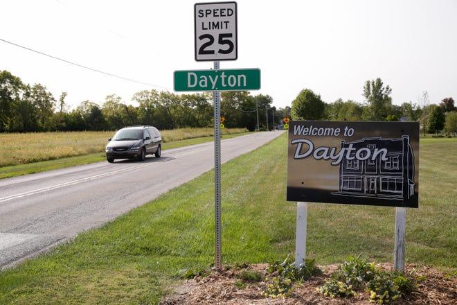 A car drives along Dayton Road, Monday, Sept. 21, 2020 in Dayton.