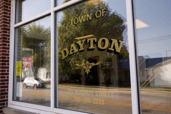 Main Street is reflected in the windows of the Dayton town hall, Monday, Sept. 21, 2020 in Dayton.