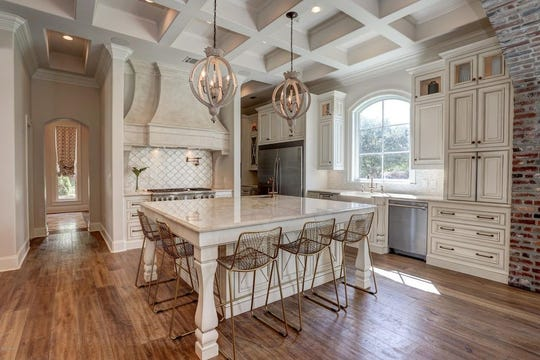 Gourmet kitchen with professional appliances, large island, separate breakfast room and large keeping room. The mansion, on the market for $2.5 million offers, outside kitchen, with a gentlemen's room, in-home theater and a full outside kitchen.