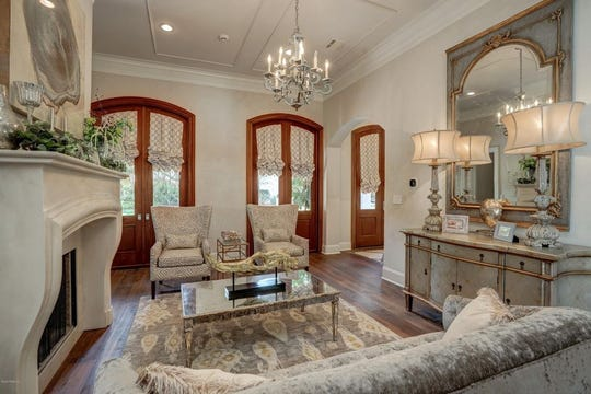 The foyer is paired by a formal living, with a fireplace, and a formal dining room.This River Ranch home, with6,465 square feet, is designed to entertain, with a gentlemen's room, in-home theater anda full outside kitchen.
