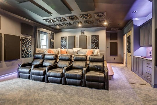 The home also has a theater room, with details throughout that include antique beams, bricked wall, custom drapery, and stunning ceiling treatments.The home also boasts fivefireplaces.This mansion, on the market for$2.5 million, offers outside kitchen, with a gentlemen's room, in-home theater anda full outside kitchen.