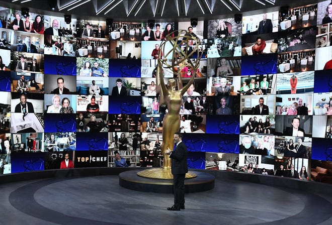 Host Jimmy Kimmel checks in with this year's nominees remotely  at the 72nd Primetime Emmy Awards Sunday night at the Staples Center.