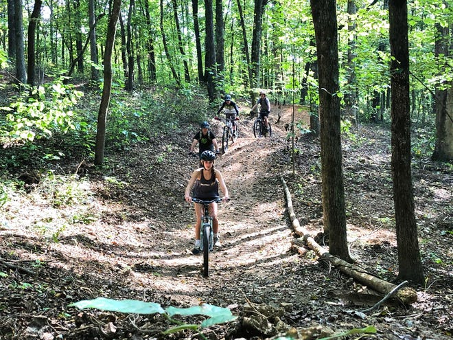 Riders take advantage of the newly built mountain bike trails at Wilkins Branch Mountain Bike Park, which opened Sunday, Sept. 20, 2020.