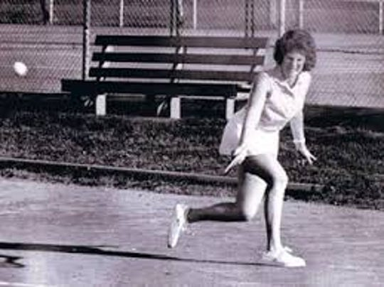 Abbe Seldin, in 1972, striking a backhand in a tennis match.  Seldin, as a 15-year-old sophomore at Teaneck H.S. and a ranked girls tennis player by the Eastern Lawn Tennis Association, went to federal court in Newark for the right to play on the boy's tennis team.  Her attorney was Ruth Bader Ginsburg.  Because of Seldin's lawsuit, the New Jersey State Interscholastic Athletic Association changed its rules barring girls from boy's sports.  Seldin made the Teanek tennis team but quit because of mistreatment from the coach.