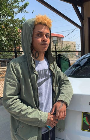 Las Cruces resident Lucas Rosales, 19, took his vehicle to an auto repair shop Monday, Sept. 21, 2020, to repair a broken rear window after an alleged hate crime in the early morning hours of Saturday, Sept. 19, at the Pic Quik on Amador Avenue.