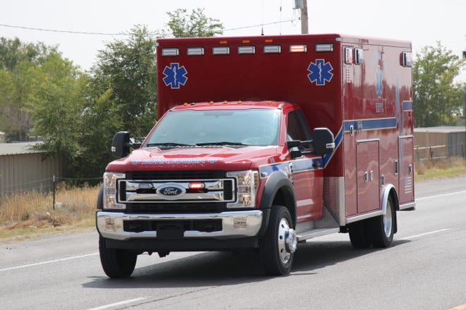 An Artesia Fire Department ambulance leaves an accident scene south of Artesia on United States Highway 285 on Sept. 21, 2020.