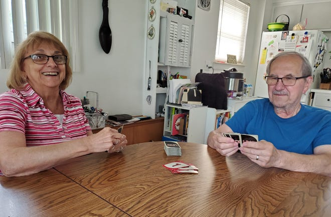 Florence and Mike Nagy playing a hand of Uno.