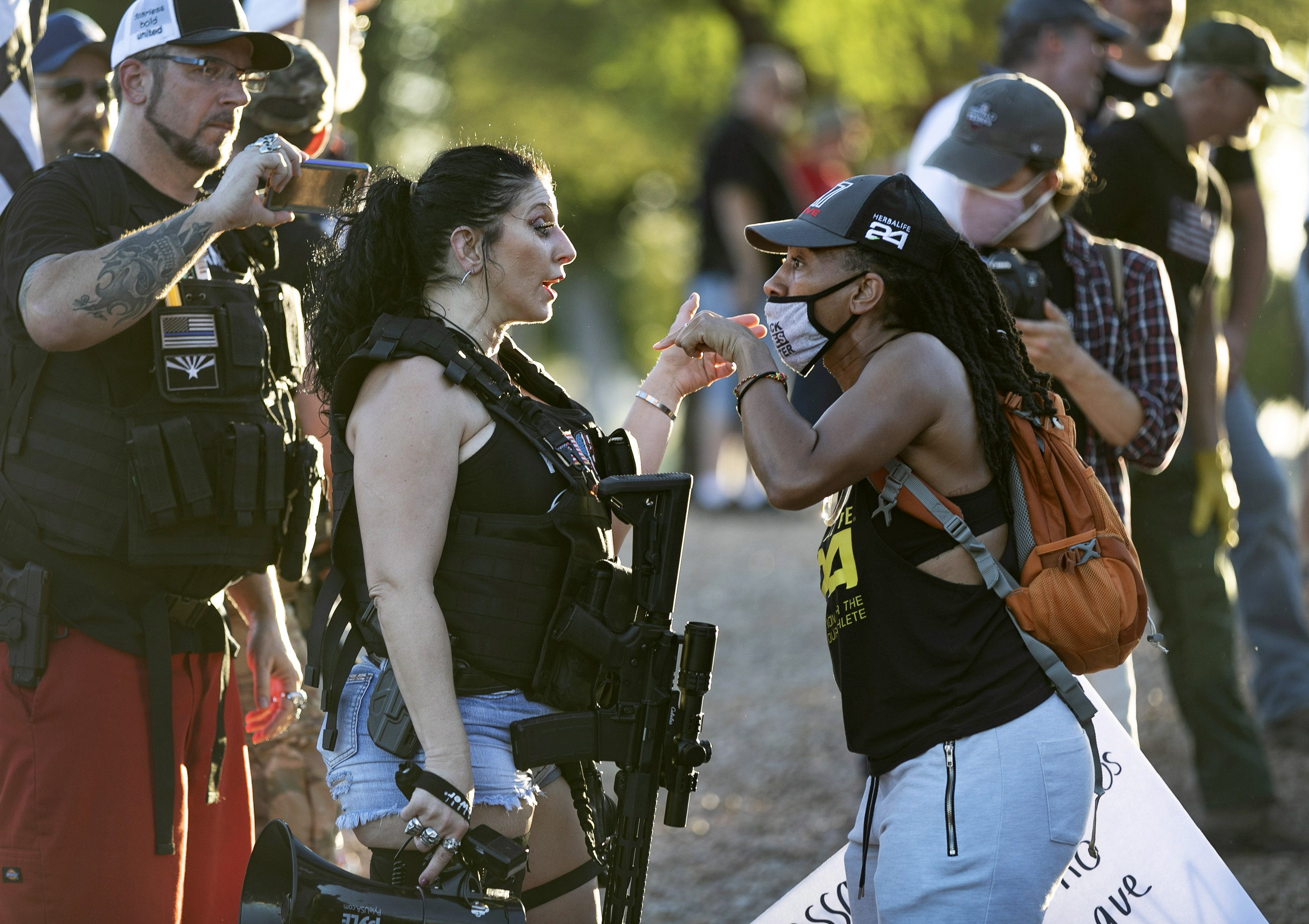 Jennifer Harrison (left) of the AZ Patriots argues with a protester calling for ending systematic racism at an event led by The W.E. Rising Project at the Arizona state Capitol in Phoenix on July 4, 2020.
