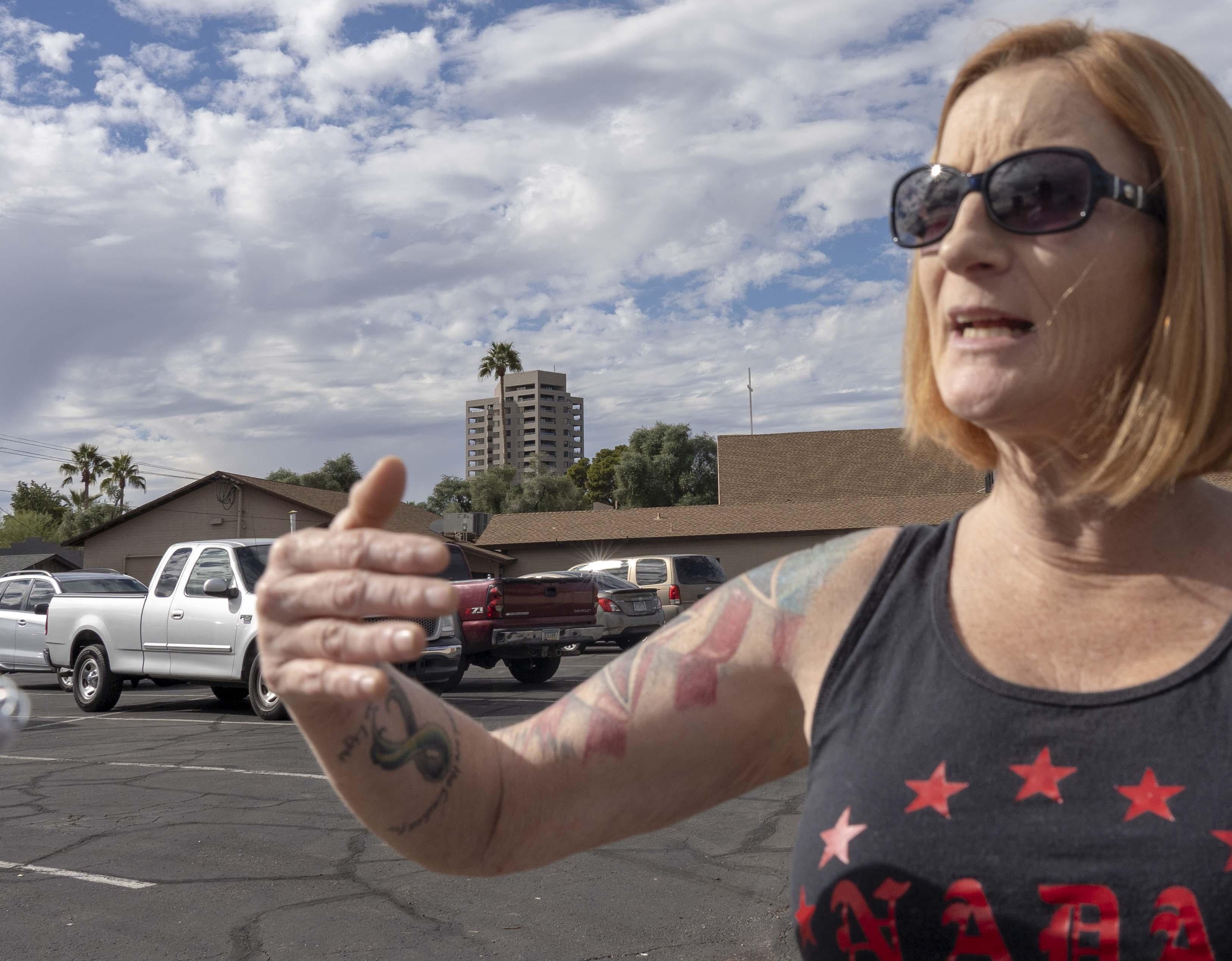 Lesa Antone, of the Patriot Movement AZ, protests outside a Phoenix-area church on Jan. 10, 2019.