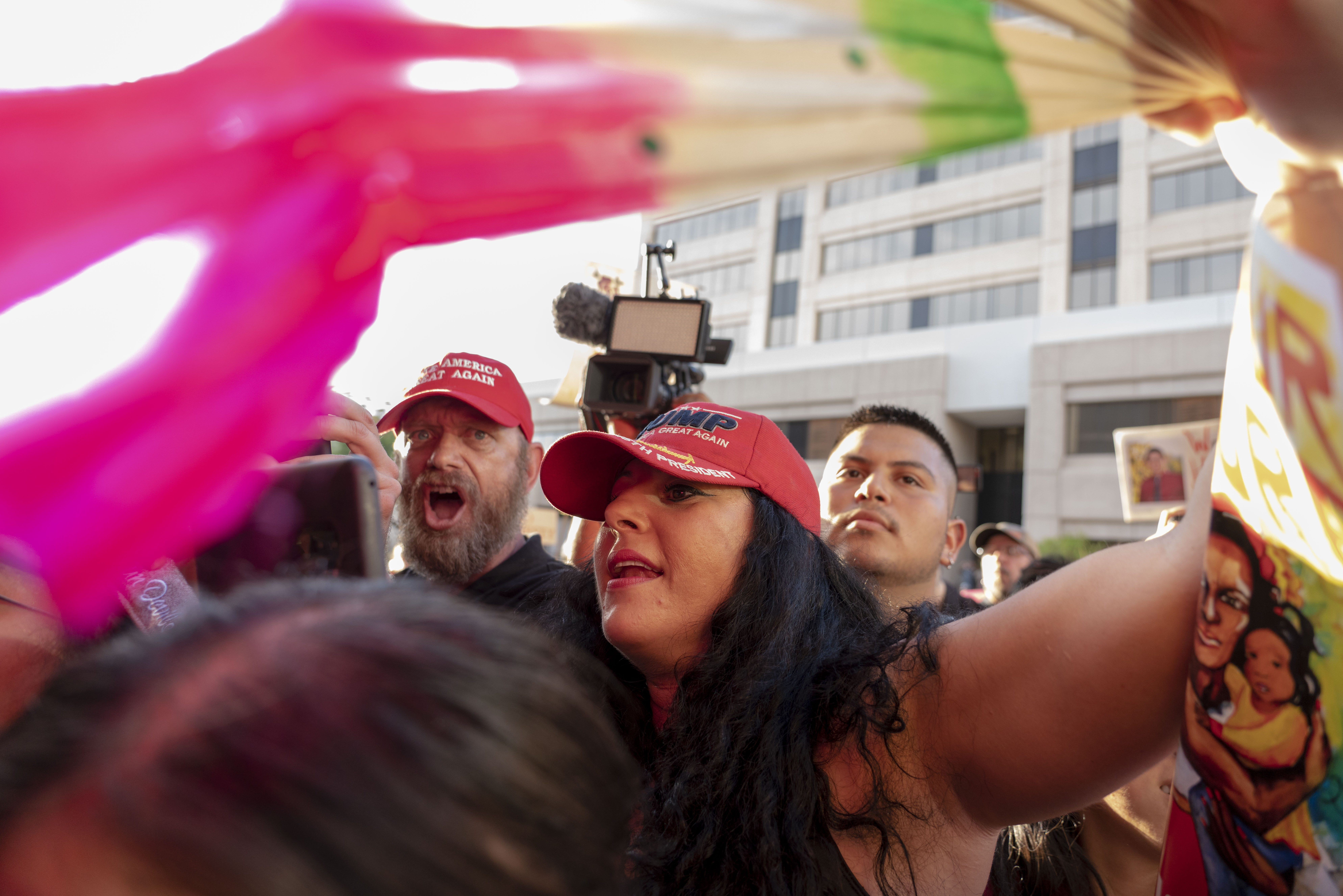 Trump supporter Jennifer Harrison, then of the Patriot Movement AZ group argues with Puente Human Rights Movement members about families impacted by immigration enforcement, outside of the 4th Ave Jail in Phoenix on Aug. 22, 2018.