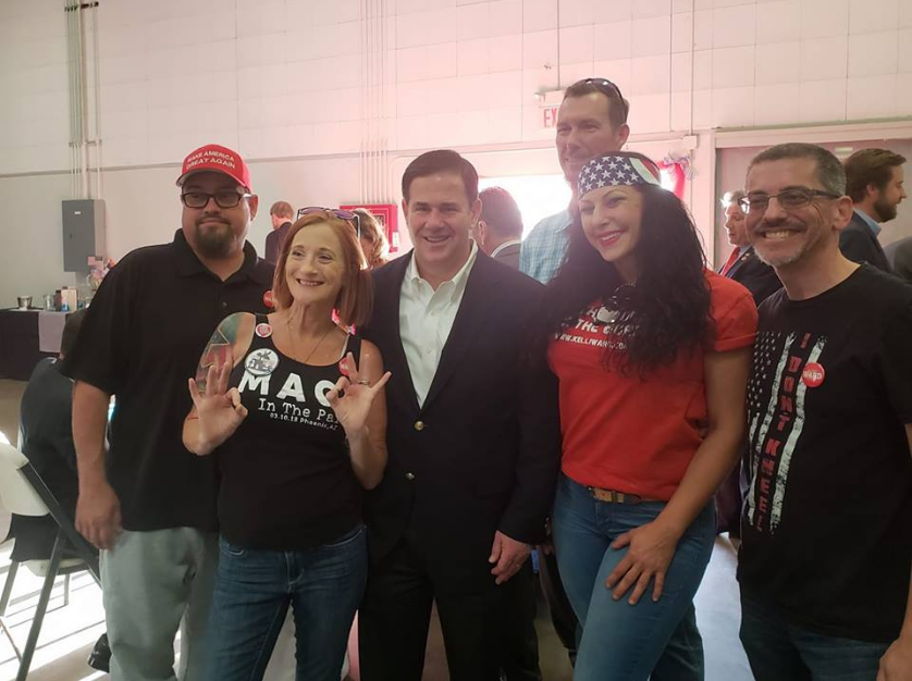 A photo posted on the Patriot Movement AZ Facebook page shows members of the Patriot Movement AZ group including Lesa Antone and Jennifer Harrison posing with Gov. Doug Ducey.