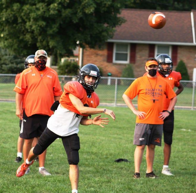 Palmyra's senior quarterback Seth Robertson fires a pass during  a recent workout.