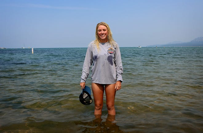 Andi Bertolina poses for a portrait after finishing the swimming leg of her Tahoe Trifecta at Ski Run Marina in South Lake Tahoe on Sept. 21, 2020.