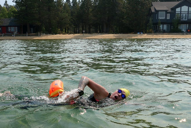 Andi Bertolina finishes the swimming leg of her Tahoe Trifecta as she approaches Ski Run Marina in South Lake Tahoe on Sept. 21, 2020.