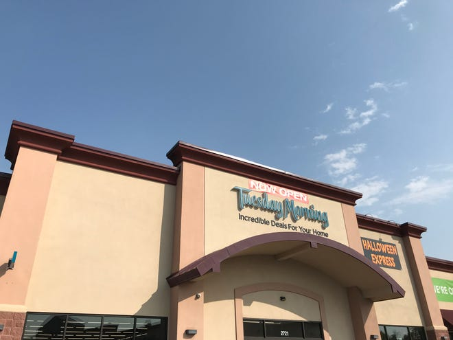 Tuesday Morning re-opened Friday after closing because of damage caused by last year's tornado.