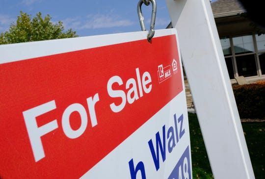 Signs are posted outside a home for sale Monday, Sept. 21, 2020, in St. Cloud.