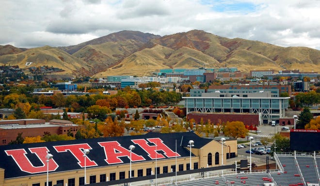 FILE - In this Oct. 23, 2018, file photo, the University of Utah campus is shown from Rice-Eccles Stadium in Salt Lake City. The University of Utah paid extortionists almost half a million dollars after a ransomware attack on some of its computer servers, and is now telling students, staff and faculty to change their university passwords. (AP Photo/Rick Bowmer, File)