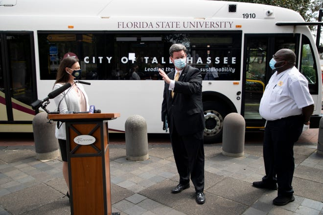 """Mayor John Dailey introduces StarMetro Transit Services Supervisor Kenneth Strong to Florida Commissioner of Agriculture and Consumer Services Nikki Fried while talking about how the """"Seminole Express"""" electric buses work at City Hall Monday, Sept. 21, 2020."""