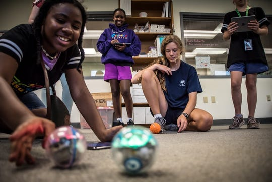 Campers work on programming robots at the 2019 SciGirls Camp at the MagLab.