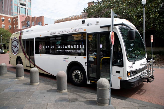 """A """"Seminole Express"""" electric bus served as the backdrop for a press conference held by Florida Commissioner of Agriculture and Consumer Services Nikki Fried and Mayor John Dailey where they highlighted National Clean Energy Week in front of City Hall Monday, Sept. 21, 2020."""