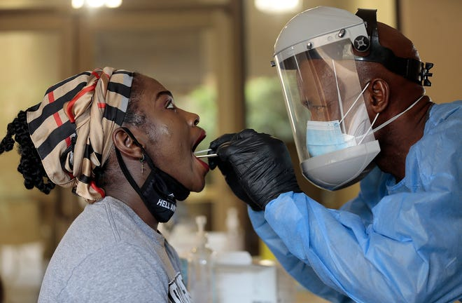 UTEP nursing student Ajuma Alfred is tested for the coronavirus Monday, Sept. 21, 2020, at the Fox Fine Arts Center on campus by Divine Ayong.