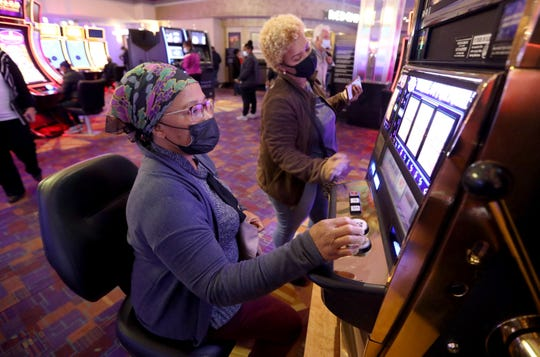 Eunice Tamakloe (left) and Juane Sambo de la Rosa of The Bronx are playing a slot machine on the first day of the reopening of the Empire City Casino in Yonkers on September 21, 2020.