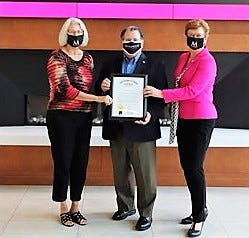 State Sen. Tim Schaffer, center, presents a proclamation to Cynthia Wilkins and Susan Hasseler of Muskingum University recognizing the nursing class of 2020 receiving 100 percent passing rate on the National Council Licensure Examination.