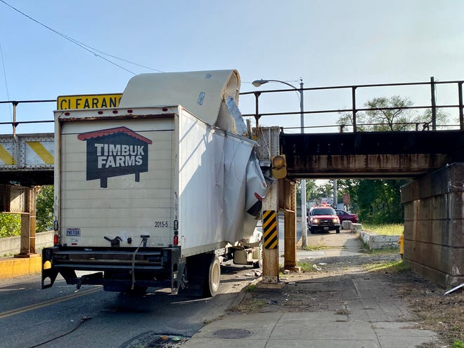 No one was hurt when a box truck crashed into the railroad overpass on Linden Avenue near the Y Bridge Monday afternoon.