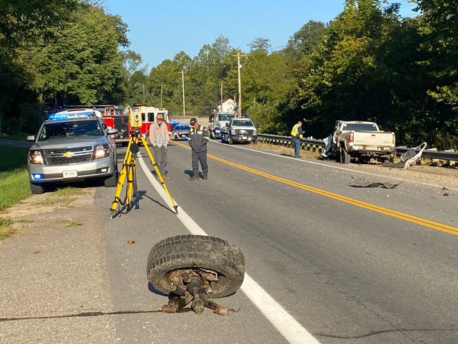 A tire sits to the side of the road after coming off one of the vehicles involved in a collision on East Pike Monday morning.