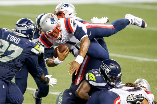 Patriots quarterback Cam Newton, airborne against the Seahawks Sunday night, is proving lots of people wrong so far this season.